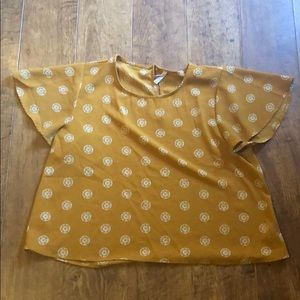 yellow blouse with white sunflower print